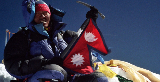 Lakpa Geljin Sherpa on the summit of Mount Everest